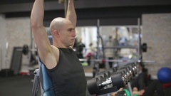 Young athletic man exercise shoulder, military shoulder press Stock Footage
