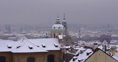 Roof tops of Prague in Winter. Snowy day Touristic view to street of the Prague Stock Footage