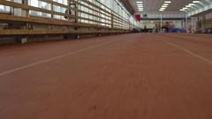Running Track at Indoor Stadium Stock Footage