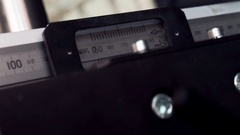Moving metal ruler. Electromechanical measuring device. Stock Footage