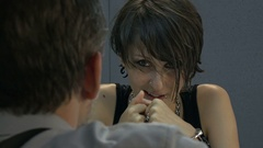 Girl hacker in the interrogation room showing at detective handcuffs Arkistovideo