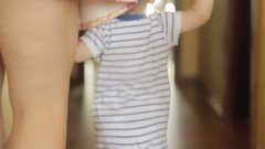 Baby boy walking with mother at home Stock Footage