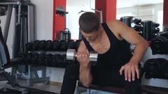 Athlete biceps dumbbells swings Stock Footage