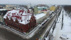 Colorful building of Victoria hotel is on the Lenin avenue at winter. Vyborg Stock Footage