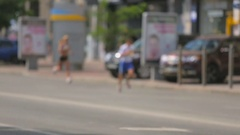 Blurred shot of young man running to the finish at city marathon Stock Footage
