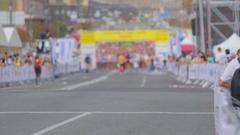 Runners preparing on start line at city marathon Stock Footage