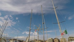 Sailboat Masts and a Wind Generator that rotates, at Harbor Stock Footage