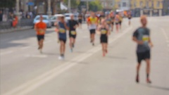 Blurred shot of big group of people on city marathon at sunny day Stock Footage