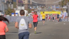 Rear view shot of exhausted runner on city marathon Stock Footage