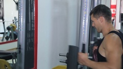 Athlete doing exercise on a simulator Stock Footage