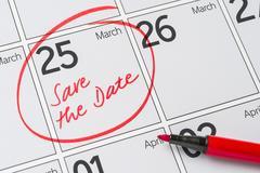 Save the Date written on a calendar - March 25 Stock Photos