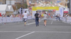Exhausted people running to the finish on city marathon day Stock Footage