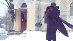 Young business girl walking in the winter city . Clothing styles of Gothic Stock Footage
