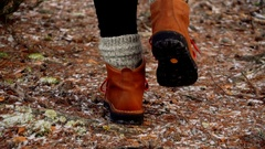Winter boots in the forest Stock Footage