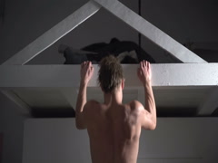 Back view of young man doing pull ups. Muscular strong man doing exercise. Stock Footage