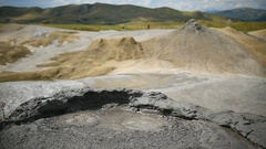 Mud volcanoes also known as mud domes boiling in summer season Stock Footage