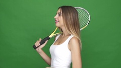 Happy smiling woman holding tennis racquet and throwing ball Stock Footage