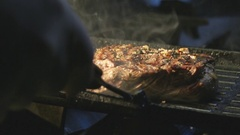 Steak professional cooking on grill by chef in restaurant Stock Footage