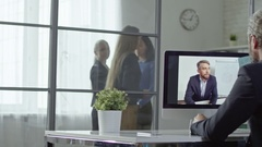 Office Workers on Video Call with CEO Stock Footage