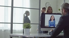 Talking on Web Camera in the Office Stock Footage