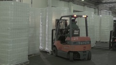 Loading of goods in the warehouse using forklift Stock Footage