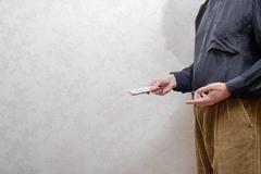 Man Paying  a Dollars Bribe for corruption Stock Photos