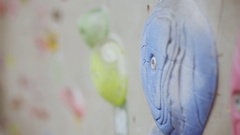 Elements of indoor rock climbing wall in a sport facility Stock Footage