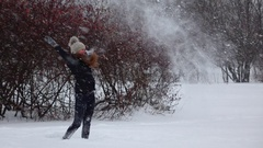 Young woman throw up fluffy snow, nice blizzard slow motion Stock Footage