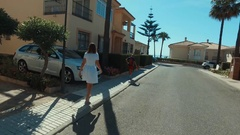 Happy family son and mam woking in the street on the way to hotel,Malaga Spain Stock Footage