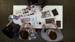 Young designers working with color palette and samples at office desk Stock Footage