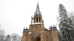 Romantic orthodox church of apostles Peter and Paul in snowy park, tilt down Stock Footage