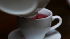 Woman stirs hot fruit tea in cafe Stock Footage