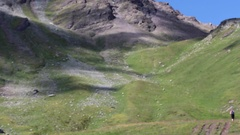 Mountain rural path - Alpine pastures Stock Footage