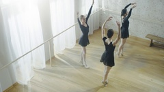 Three Young and Gorgeous Ballerinas Practicing Synchronous Dancing and Wirling.  Stock Footage