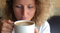 Woman Addicted to Caffeine Looking at Coffee Cup Stock Footage