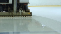 Machine cleans ice skating rink Stock Footage