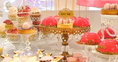 """Delicious sweet buffet with cupcakes, meringues and other desserts. With """"Eat me Stock Footage"""