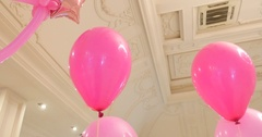 Pink Balloons white wall background Arkistovideo