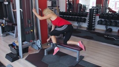 Beautiful sporty woman doing workout in gym Stock Footage