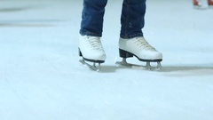 Young woman skating on ice with figure skates Stock Footage