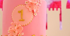 First birthday celebration cake with number one and macaroons Stock Footage