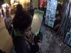 Night Market artist draws close Stock Footage
