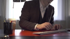 Man works at his desk answers phone Stock Footage