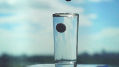 Putting pill in glass with water in slowmotion. Aspirin splash, headache Stock Footage