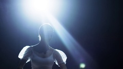 Mid Shot of a Beautiful Young Ballerina Dancing Gracefully in the Spotlight Stock Footage