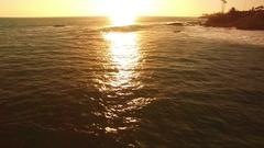 Laguna Beach Sunset Aerial Shot of California Coast USA - Surfers Stock Footage