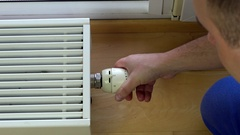 Man control climate at home Stock Footage