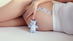 Pregnant girl stroking her belly Stock Footage