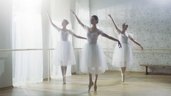 Three Young and Gorgeous Ballerinas Synchronously Dancing. They Wear White Dress Stock Footage