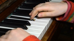 Kid hands on a piano key Stock Footage